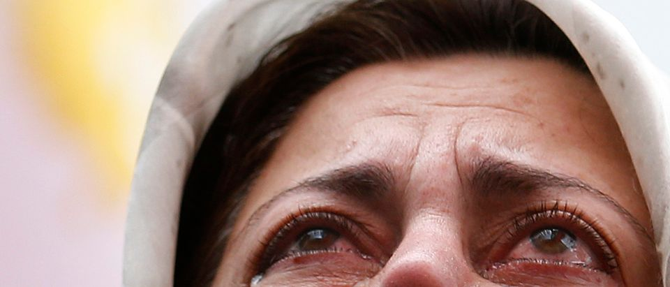 A supporter of the People's Mojahedin Organization Of Iran cries as she demonstrates outside the U.S. Embassy in London