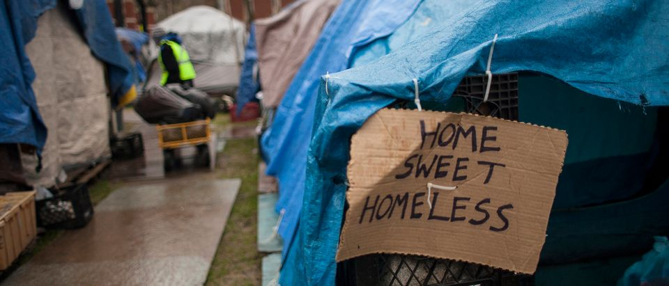 A sign on a tent is seen at Tent City 3, a homeless encampment in Seattle, Washington