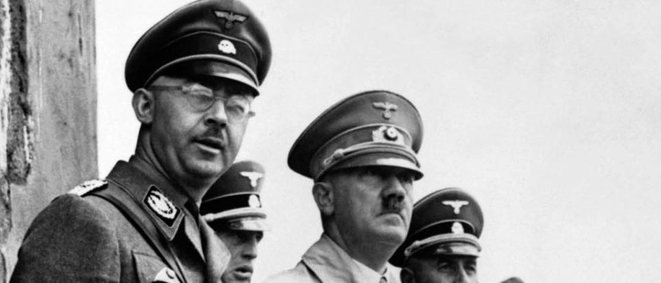 Hitler stands beside Heinrich Himmler, the head of the Gestapo, to observe a parade of Nazi Stormtroopers in this file photo from 1940. Reuters/Handout Old