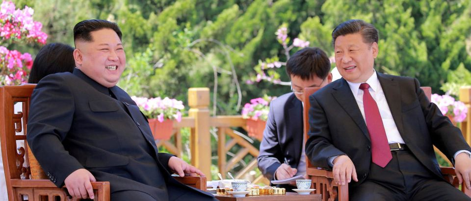 North Korean leader Kim Jong Un meets with China's President Xi Jinping, in Dalian, China in this undated photo released on May 9, 2018 by North Korea's Korean Central News Agency (KCNA)