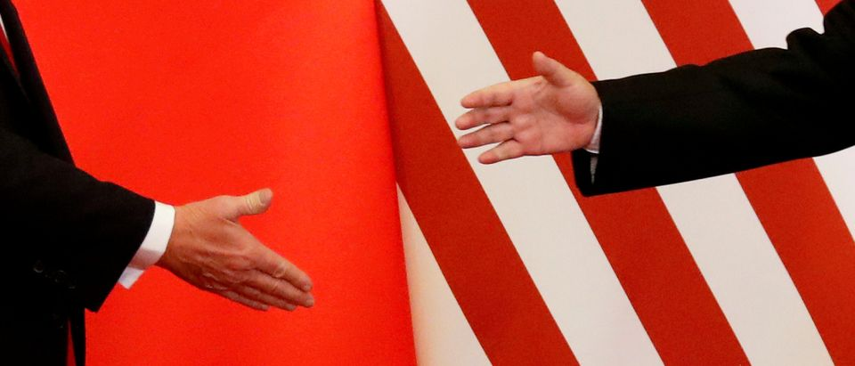 FILE PHOTO: U.S. President Donald Trump and China's President Xi Jinping shake hands in Beijing