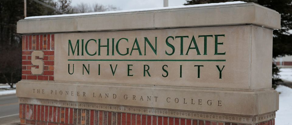 A sign for Michigan State University is seen near the campus in East Lansing, Michigan, U.S., February 1, 2018. REUTERS/Rebecca Cook