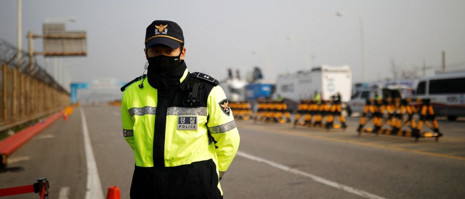 A police officer stands guard on the Grand Unification Bridge that leads to the Peace House, the venue for the Inter-Korean summit, near the demilitarized zone separating the two Koreas, in Paju, South Korea, April 27, 2018. REUTERS/Kim Hong-ji