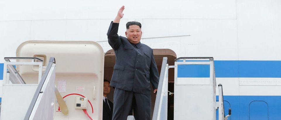 North Korea's leader Kim Jong Un waves before departing Pyongyang to Singapore