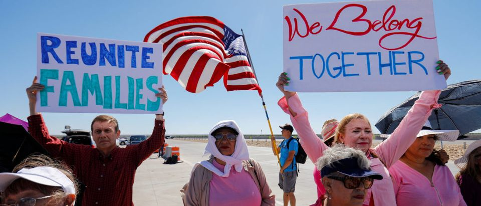 """A small group of demonstrators protests outside of the children's tent encampment built to deal with the Trump administrations """"zero tolerance"""" policy in Tornillo, Texas, U.S. June 21, 2018. REUTERS/Mike Blake"""