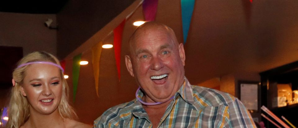 Legal brothel owner Dennis Hof (R), who recently won the Republican primary election for Nevada State Assembly District 36, is entertained by drag queen Savannah Jewel during a birthday party for his campaign manager in Mound House, Nevada, U.S. June 16, 2018. REUTERS/Steve Marcus