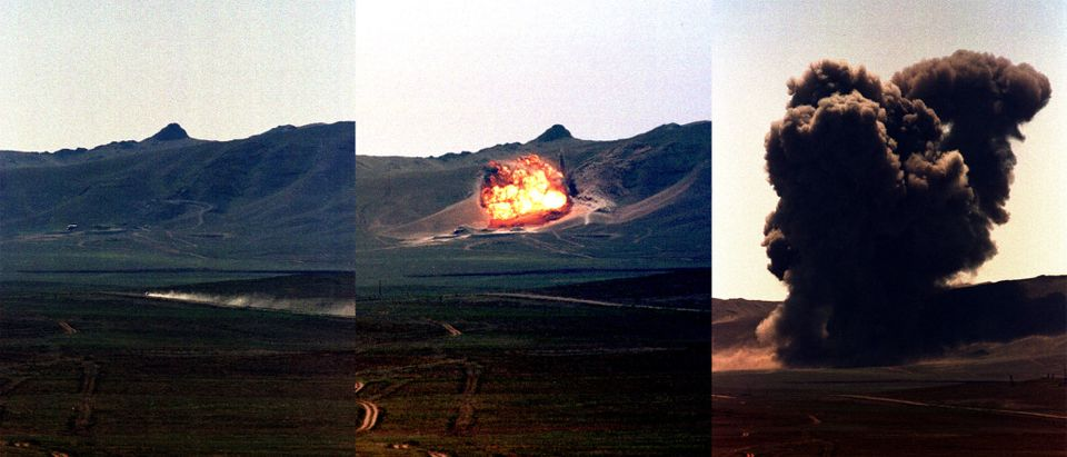 The combined picture shows the general view and the destruction of the last part of a Soviet-era nuc..