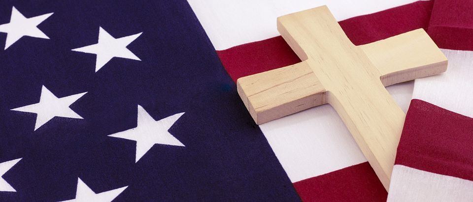 Wooden cross wrapped in American flag. Excalibur_Media Royalty-free stock photo ID: 421892704