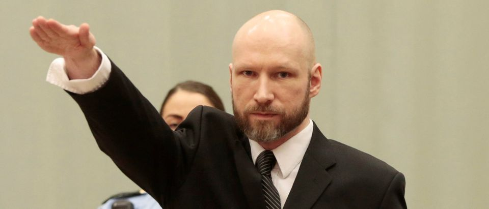 Anders Behring Breivik raises his right hand during the appeal case in Borgarting Court of Appeal at Telemark prison in Skien