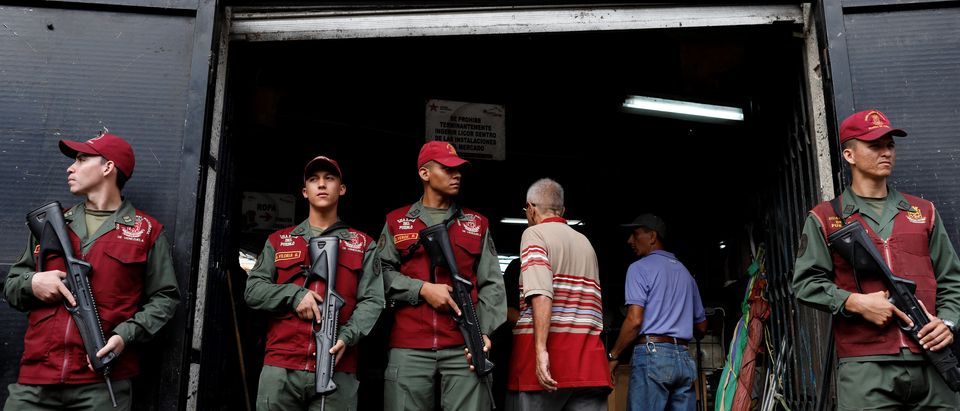 Venezuela's National Guards stand guard during a special inspection of Venezuelan soldiers to a municipal market in Caracas
