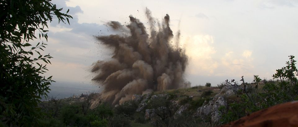FILE -- Debris and smoke rise during what rebel fighters said was an operation in which they blew up a tunnel targeting a post controlled by forces loyal to Syria's President Bashar al-Assad, in Ariha town in Idlib province May 12, 2015. REUTERS/Ammar Abdullah