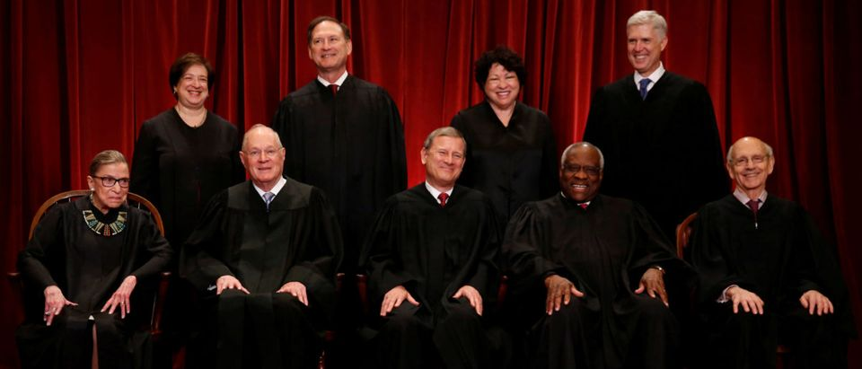 Roberts leads the U.S. Supreme Court in taking a new family photo including Gorsuch, their most recent addition, at the Supreme Court building in Washington