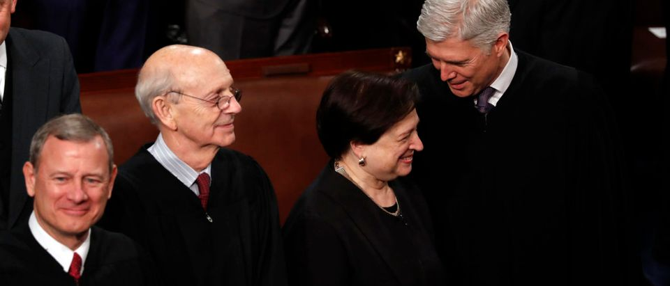 U.S. Supreme Court Justices John Roberts, Stephen Breyer, Elena Kagan and Neil Gorsuch talk as they attend U.S. President Donald Trump's State of the Union address to a joint session of the U.S. Congress on Capitol Hill in Washington, U.S. January 30, 2018. REUTERS/Jonathan Ernst