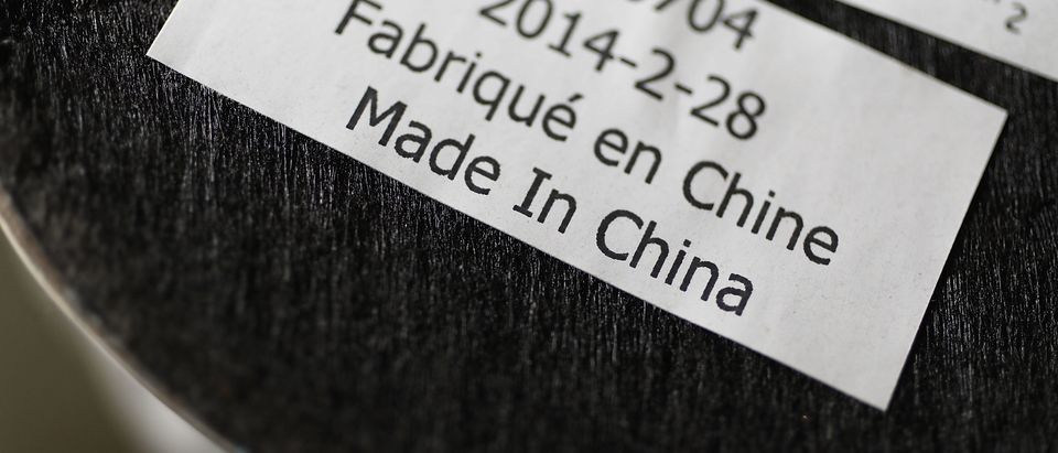 MIAMI, FL - JUNE 15: In this photo illustration, a Made in China tag is seen on an device on the day President Donald Trump announced tariffs on $50 billion of Chinese products on June 15, 2018 in Miami, Florida. China responded by saying they will reciprocate the tariffs on American goods. (Photo illustration by Joe Raedle/Getty Images)