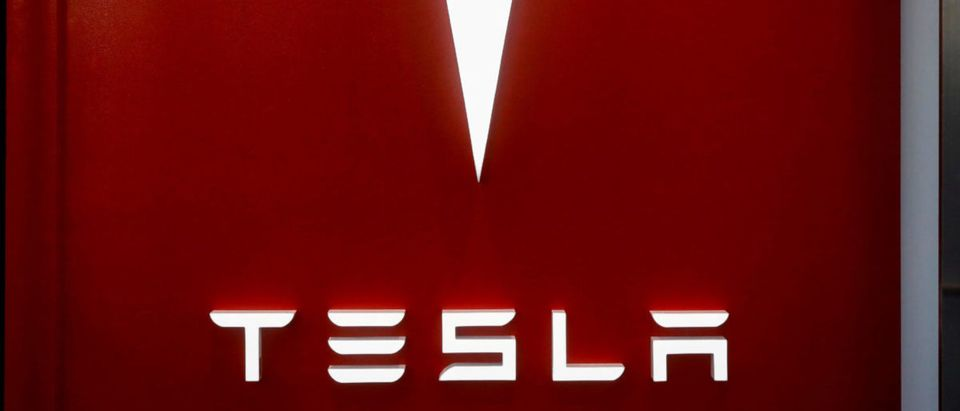 The Tesla logo is seen at the entrance to Tesla Motors' new showroom in Manhattan's Meatpacking District in New York City, U.S., December 14, 2017. REUTERS/Brendan McDermid/File Photo
