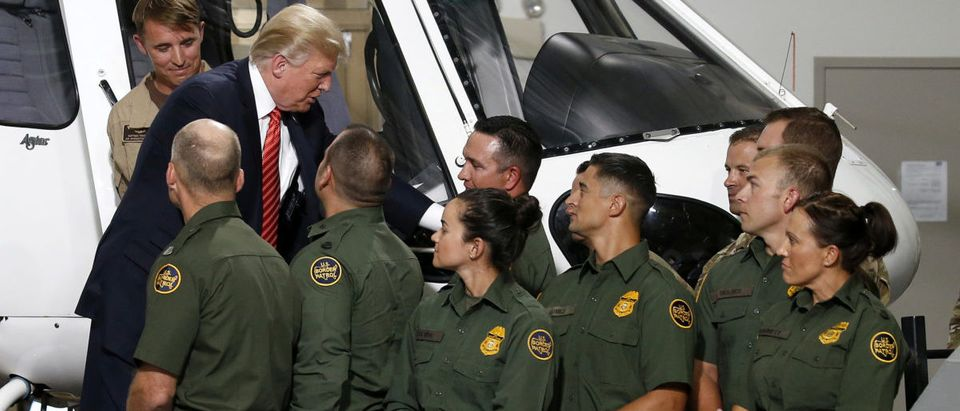 U.S. President Donald Trump greets Border Patrol agents as he tours the U.S. Customs and Border Patrol facility in Yuma