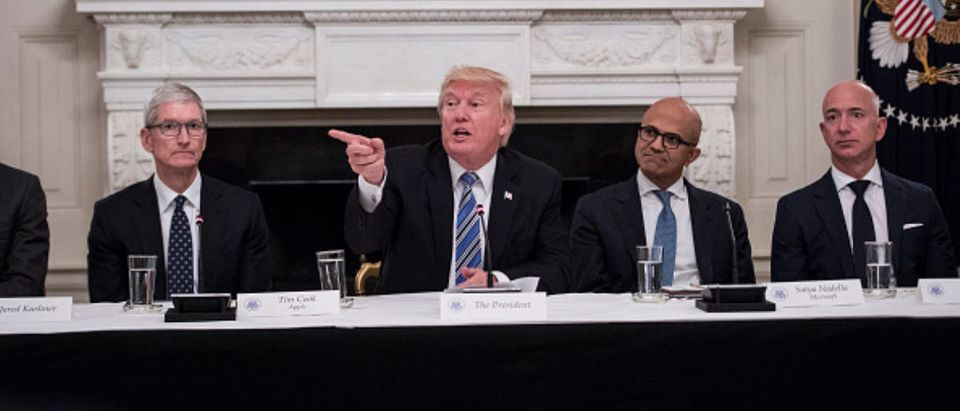 President Donald Trump speaks during an American Technology Council roundtable in the State Dinning Room at the White House in Washington, DC on Monday, June 19, 2017. From left, Tim Cook, Chief Executive Officer of Apple, Trump, Satya Nadella, Chief Executive Officer of Microsoft, and Jeff Bezos, Chief Executive Officer of Amazon. (Photo by Jabin Botsford/The Washington Post via Getty Images)