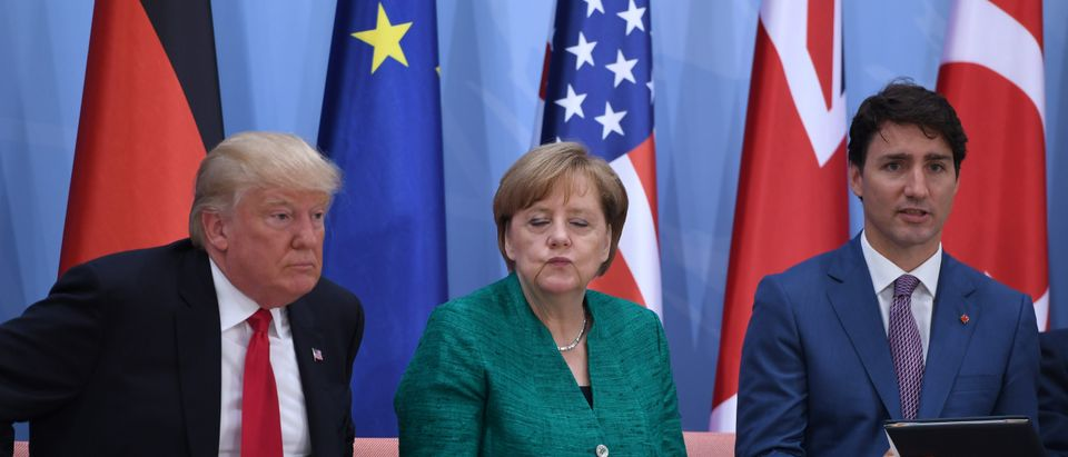 """(L-R) US President Donald Trump, German Chancellor Angela Merkel and Canada's Prime Minister Justin Trudeau attend the panel discussion """"Launch Event Women's Entrepreneur Finance Initiative"""" on the second day of the G20 Summit in Hamburg, Germany, July 8, 2017. REUTERS/Patrik STOLLARZ/Pool - RC13A134C320"""