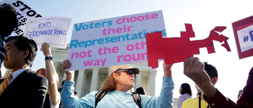 Demonstrators rally during oral arguments in Gill v. Whitford, a case about partisan gerrymandering in electoral districts, at the Supreme Court in Washington, U.S., October 3, 2017. REUTERS/Joshua Roberts