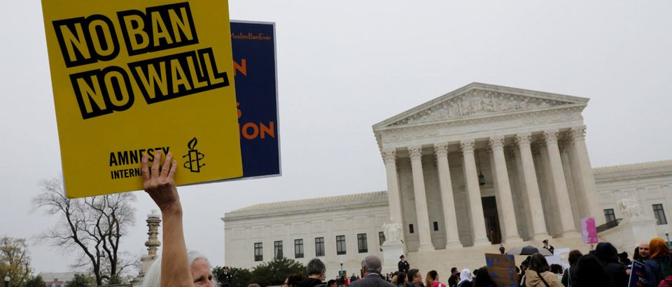 A protester holds a placard outside the U.S. Supreme Court in Washington