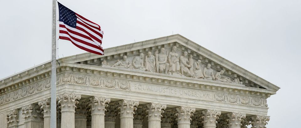 The U.S. Supreme Court is seen after the court revived Ohio's contentious policy of purging infrequent voters from its registration rolls, overturning a lower court ruling that Ohio's policy violated the National Voter Registration Act, in Washington, U.S., June 11, 2018. REUTERS/Erin Schaff - HP1EE6B1728YQ - RC1D9E04C190