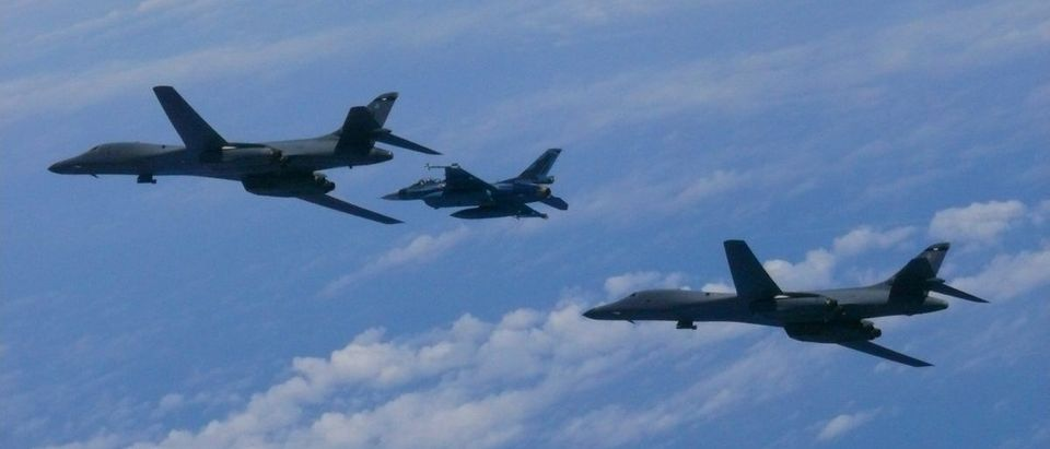 Two U.S. Air Force B-1B Lancer bomber aircraft fly with a Japan Air Self-Defense Force fighter jet over the East China Sea