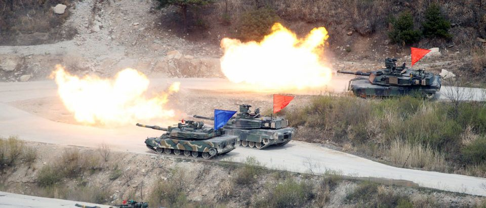 FILE PHOTO: South Korean Army K1A1 and U.S. Army M1A2 tanks fire live rounds during a U.S.-South Korea joint live-fire military exercise at a training field near the DMZ in Pocheon