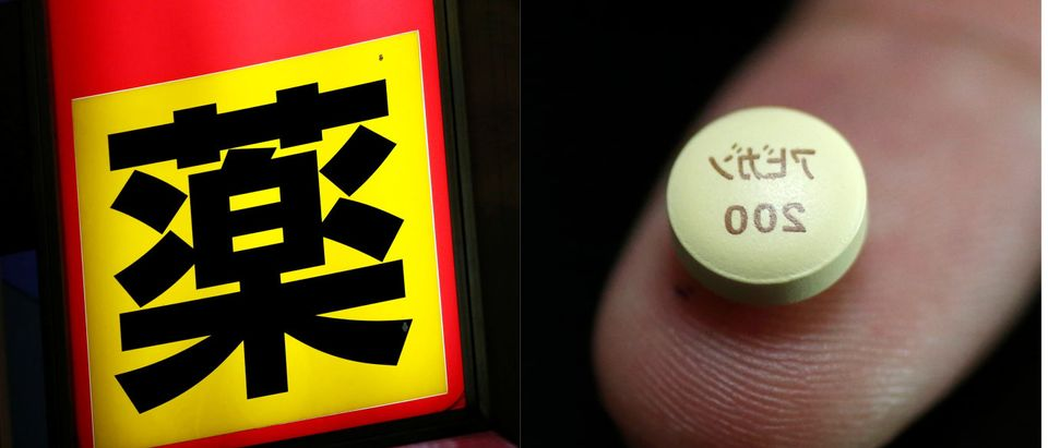 Japanese medicine sign and Japanese tablet, Reuters/ Kim Kyung-Hoon and Issei Kato