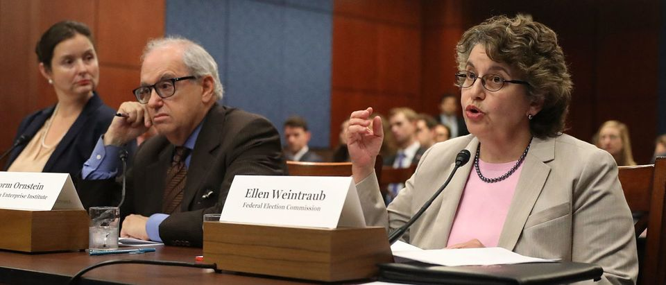 "WASHINGTON, DC - JULY 19: Ellen Weintraub, commissioner of the Federal Election Commission speaks as Norm Ornstein, resident scholar at the American Enterprise Institute sits next to her during the Democratic Policy and Communications Committee hearing in the Capitol building on July 19, 2017 in Washington, DC. The hearing dealt with the subject of ""Democracy for Sale"" and how they feel that the campaign finance system allows foreign governments to buy Influence in the U.S. Elections and what can be done about it. (Photo by Joe Raedle/Getty Images)"