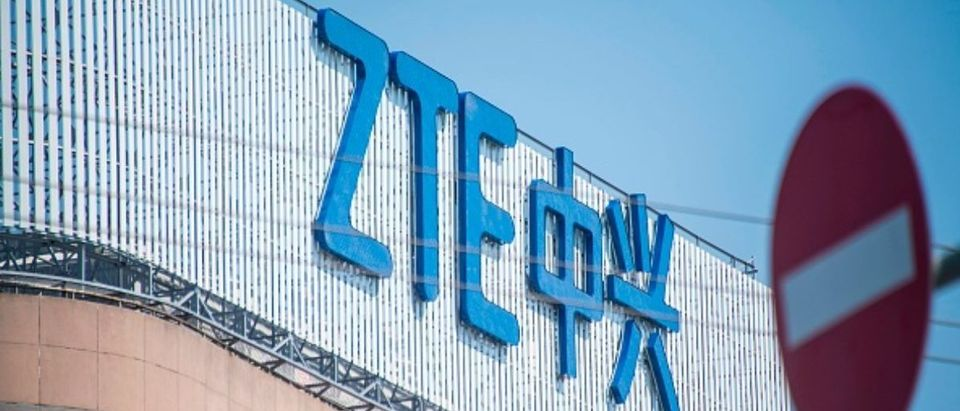 """This picture taken on May 3, 2018 shows the ZTE logo on an office building in Shanghai. - Chinese telecom giant ZTE said its major operations had """"ceased"""" following last month's US ban on American sales of critical technology to the company, raising the possibility of its collapse. (Photo: Johannes Eisele/AFP/Getty Images)"""