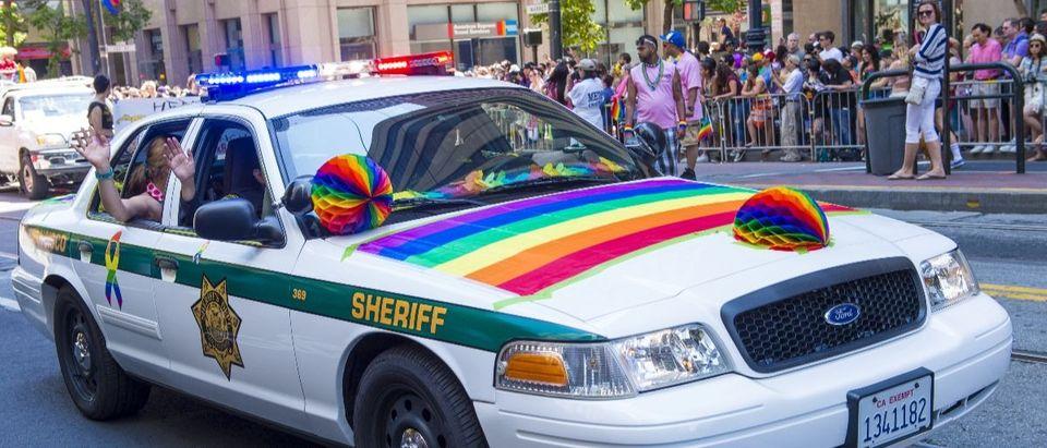 gay pride parade police car Shutterstock/Kobby Dagan