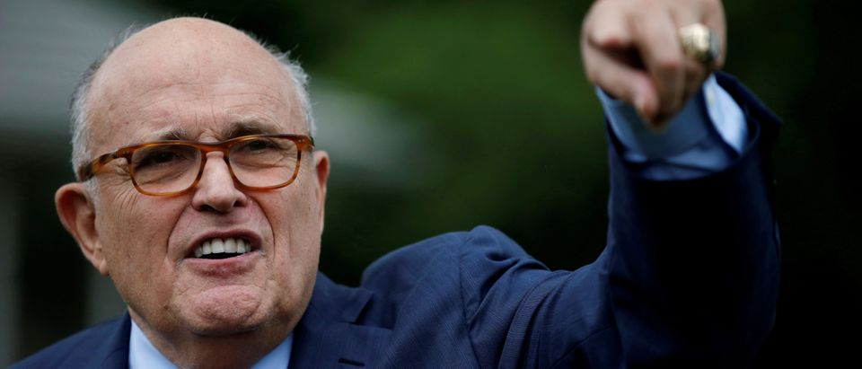 FILE PHOTO: Rudy Giuliani, attorney for U.S. President Donald Trump, arrives for the White House Sports and Fitness Day event on the South Lawn of the White House in Washington, U.S., May 30, 2018. REUTERS/Leah Millis/File Photo - RC1F733B8B00