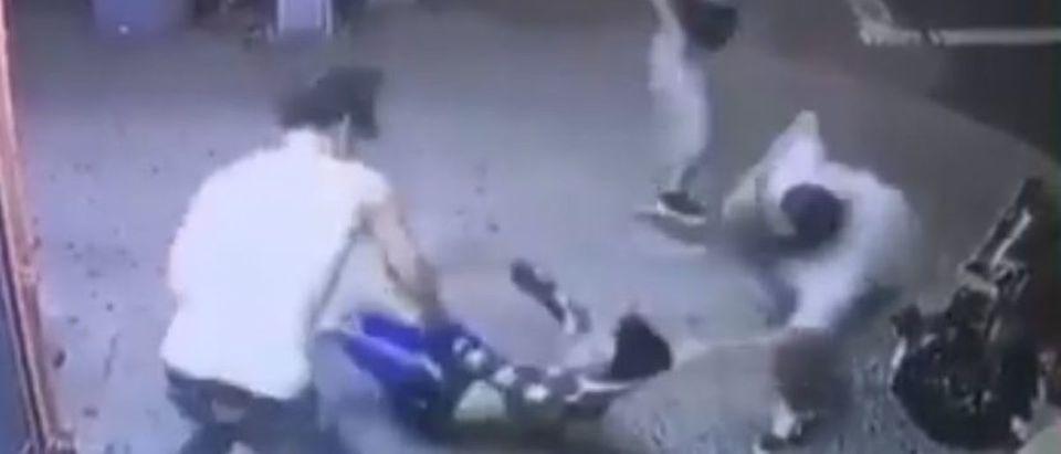 Lesandro Guzman-Feliz is attacked outside of a bodega on June 20, 2018. Twitter video screenshot