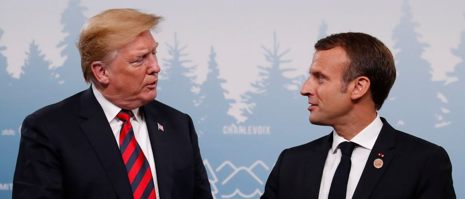 U.S. President Trump shakes hands with France's President Macron in bilateral meeting at G7 Summit in Charlevoix, Canada
