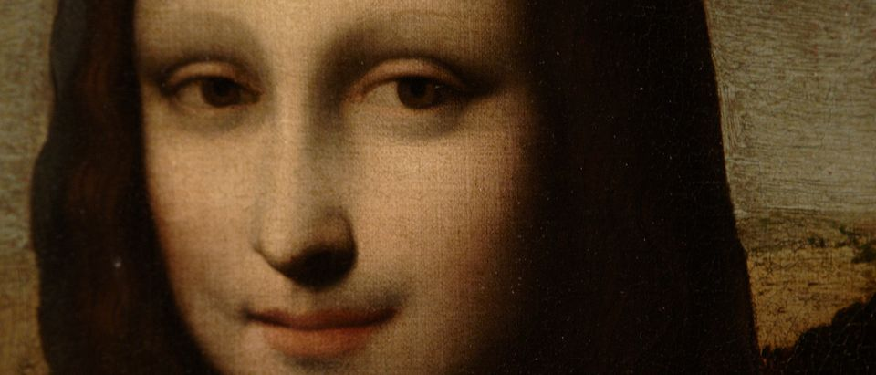 The portrait of Mona Lisa is pictured on a painting attributed to Leonardo da Vinci before a presentation in Geneva