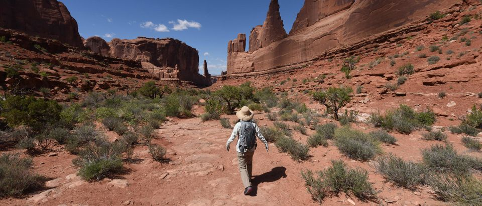 Hikers on the Park Avenue trail in the Arches National Park near Moab, Utah on April 21, 2018. (Photo: MARK RALSTON/AFP/Getty Images)