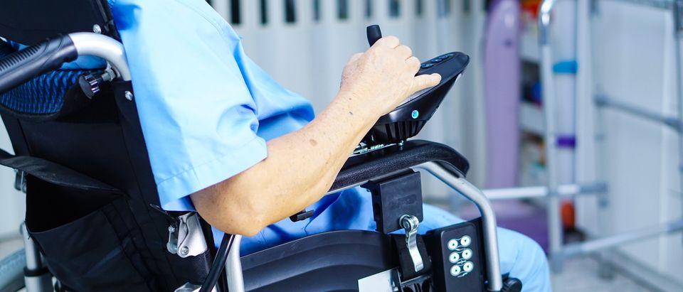 Woman in wheelchair (Photo: Shutterstock/sasirin pamai)