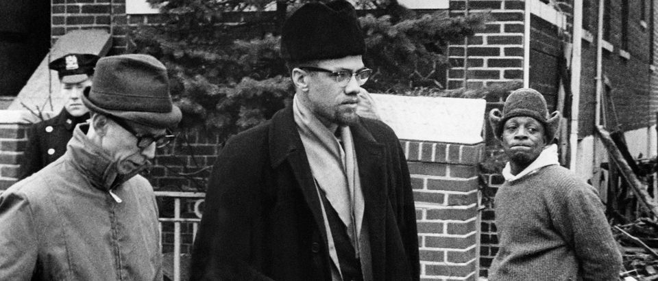 Undated picture of Malcolm X (C), the leader of the Organization for the Afro-American unity. (Photo credit should read STF/AFP/Getty Images)