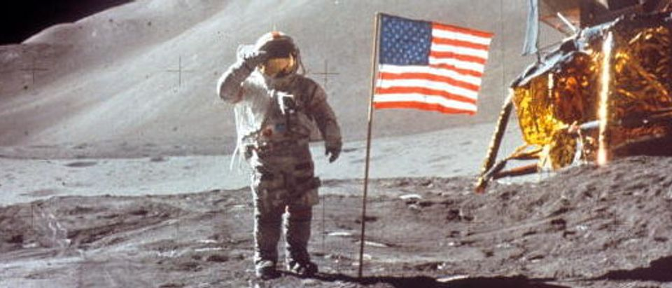 Astronaut David Scott gives salute beside the U.S. flag July 30, 1971 on the moon during the Apollo 15 mission. (Photo by NASA/Liaison)