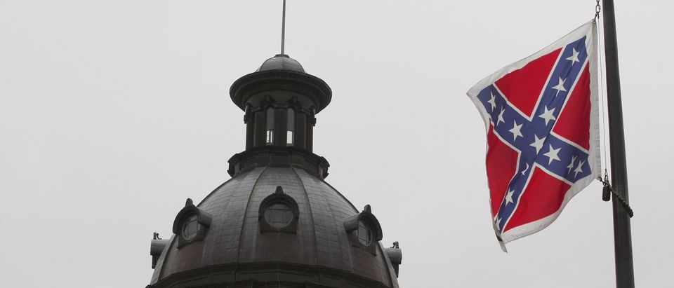A Confederate flag flies at a confederate monument in front of the South Carolina State House in Columbia