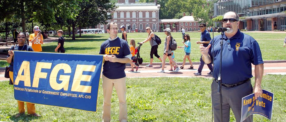Phil Glover, National Vice President of the American Federation of Government Employees, District 3, speaks during a noon-time rally on Independence Mall to protest proposed cuts in federal funding in Philadelphia