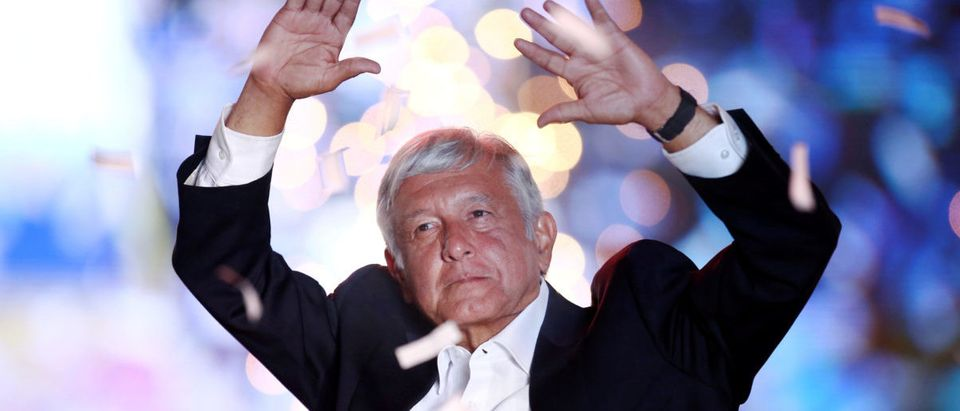 Mexican presidential candidate Andres Manuel Lopez Obrador waves to supporters during his closing campaign rally at the Azteca stadium, in Mexico City