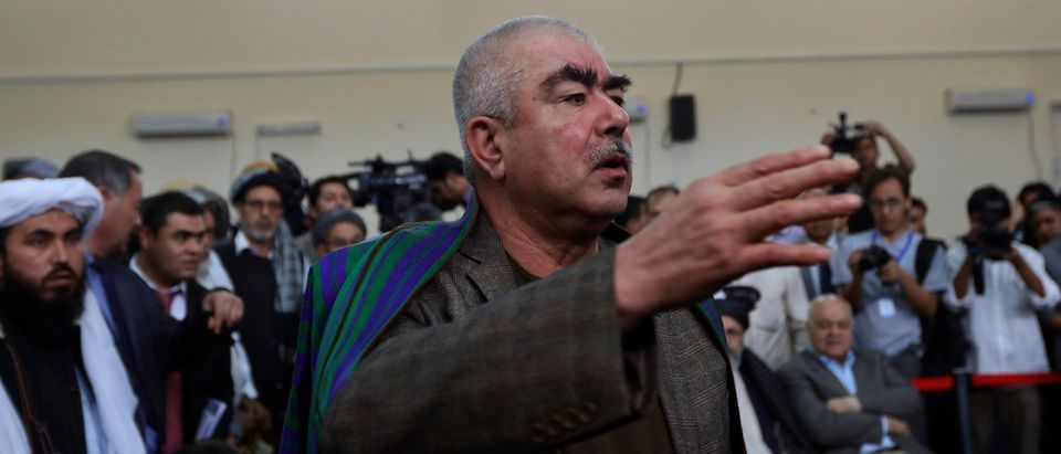 Abdul Rashid Dostum, an Uzbek leader and a vice-presidential candidate, talks with his supporters in Kabul