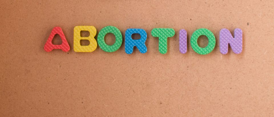 Abortion in colored letters