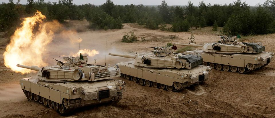 """U.S. M1 Abrams tanks fire during the """"Saber Strike"""" NATO military exercise in Adazi, Latvia, June 11, 2016. REUTERS/Ints Kalnins/"""