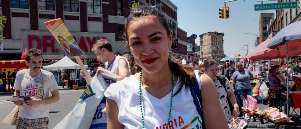 Alexandria Ocasio-Cortez marches during the Bronx's pride parade in the Bronx borough of New York City