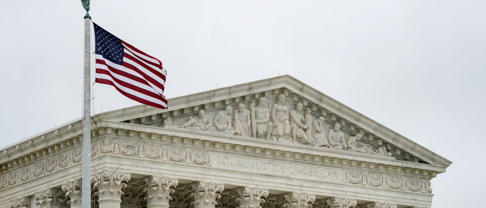 An American flag flies next to the Supreme Court of the United States (Reuters, 07/09/18)
