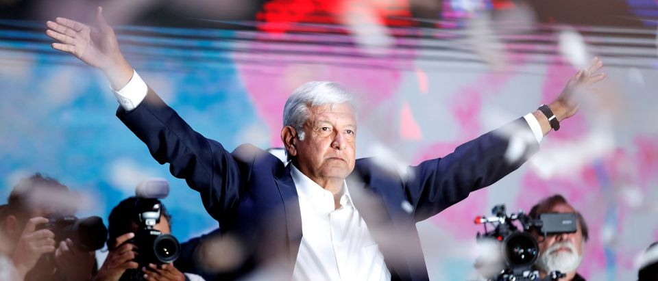 Presidential candidate Andres Manuel Lopez Obrador gestures as he addresses supporters after polls closed in the presidential election, in Mexico City