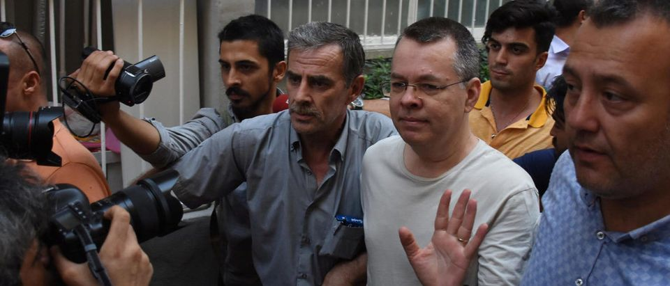 U.S. pastor Andrew Brunson reacts as he arrives at his home after being released from the prison in Izmir, Turkey July 25, 2018. Demiroren News Agency, DHA