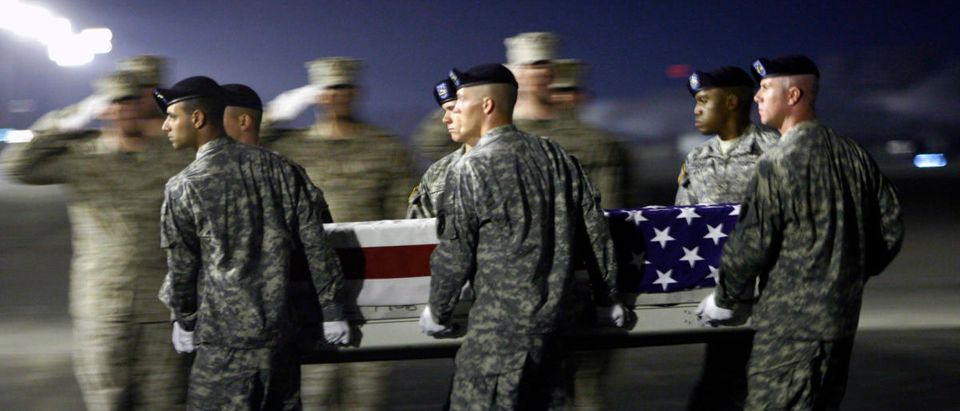 U.S. Army carry team moves the transfer case containing the body of Army private first class Pratt at Dover Air Force Base Delaware